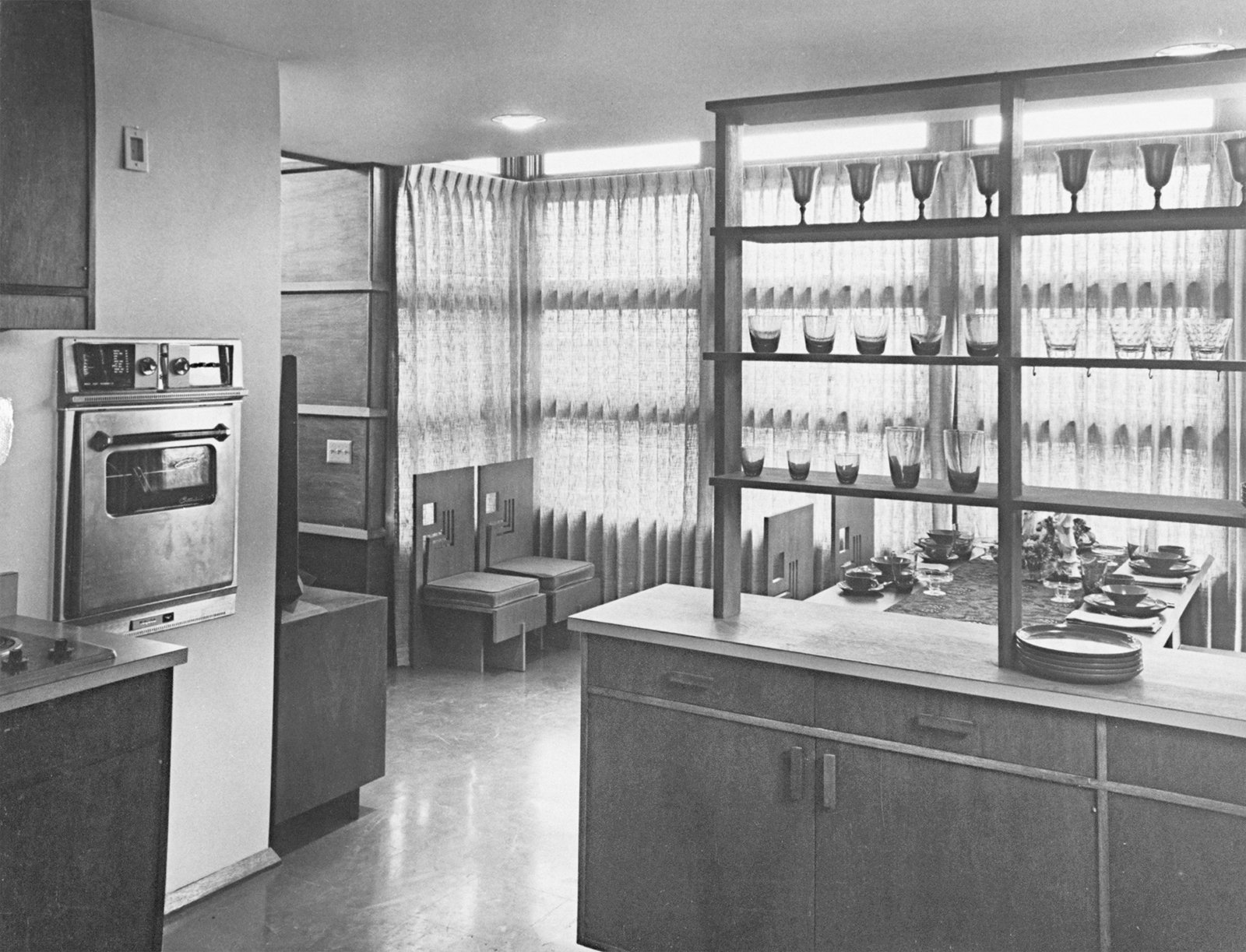 Interior of prefab house showing kitchen looking out into dining room, designed by Frank Lloyd Wright.  Photo 3 of 7 in An Introduction to Kitchen Design