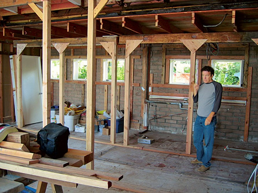After purchasing the house from an elderly neighbor, the Harrises hired architect Christopher C. Deam to help bring their sustainable visions to life. The house was practically gutted.  Photo 4 of 10 in The Bellwether of Belvedere