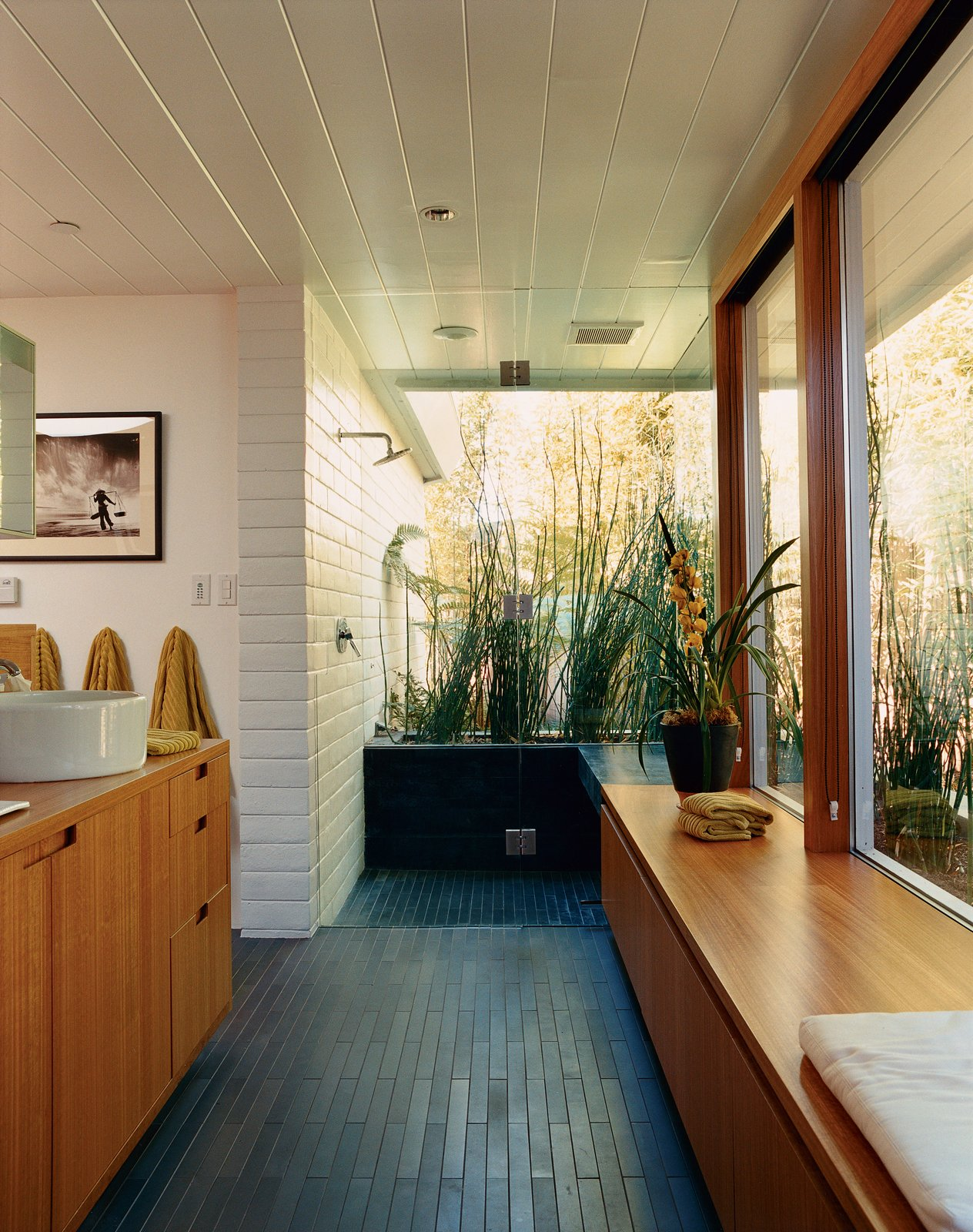 In the master bathroom, all boundaries between inside and outside and public and private are virtually eliminated. The dark tiles are by Ann Sacks.  Baths from The Bellwether of Belvedere