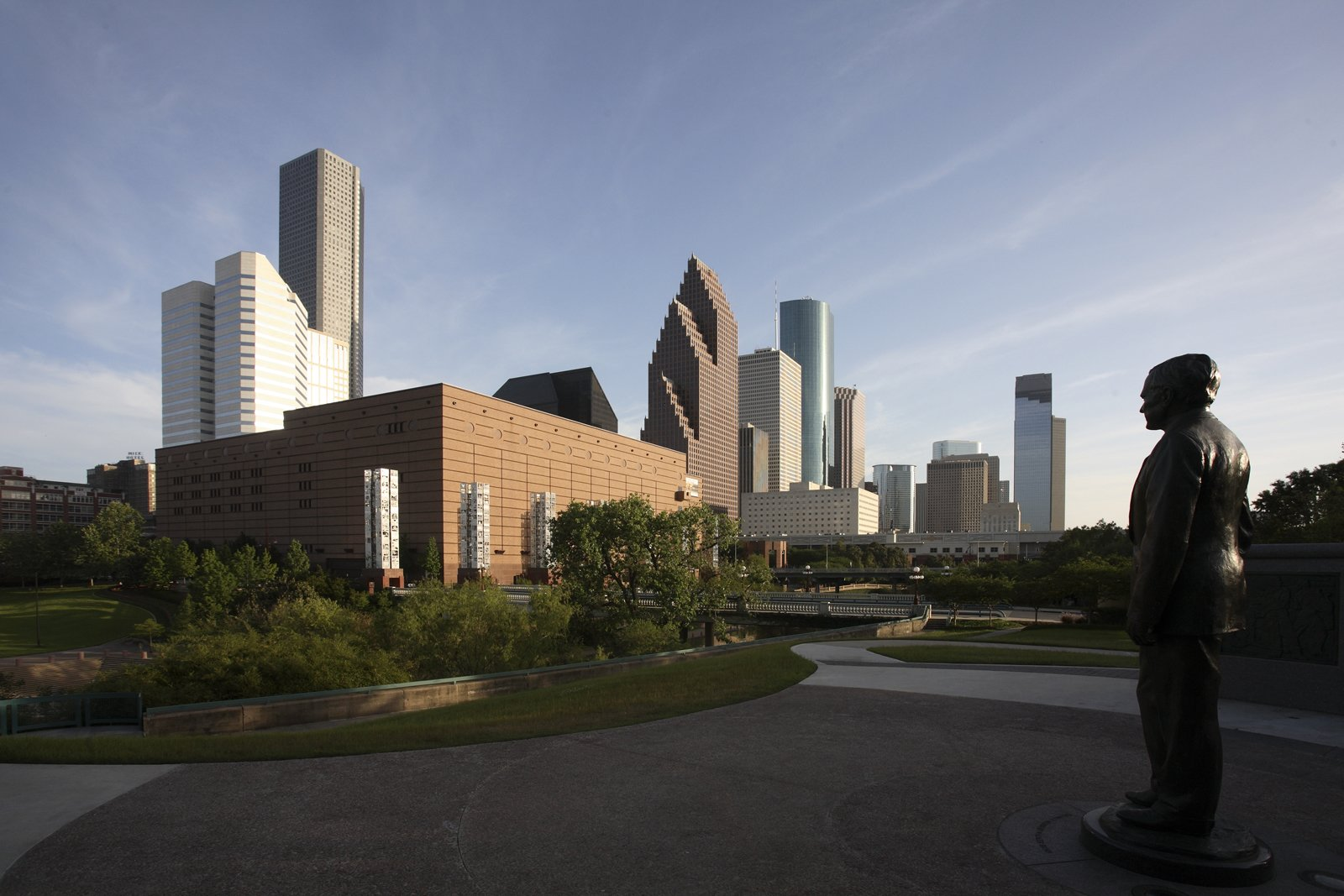 A view of the Houston skyline, with the Wortham Theater Center and the George Bush Monument in the forefront.  Photo 2 of 17 in Houston, Texas