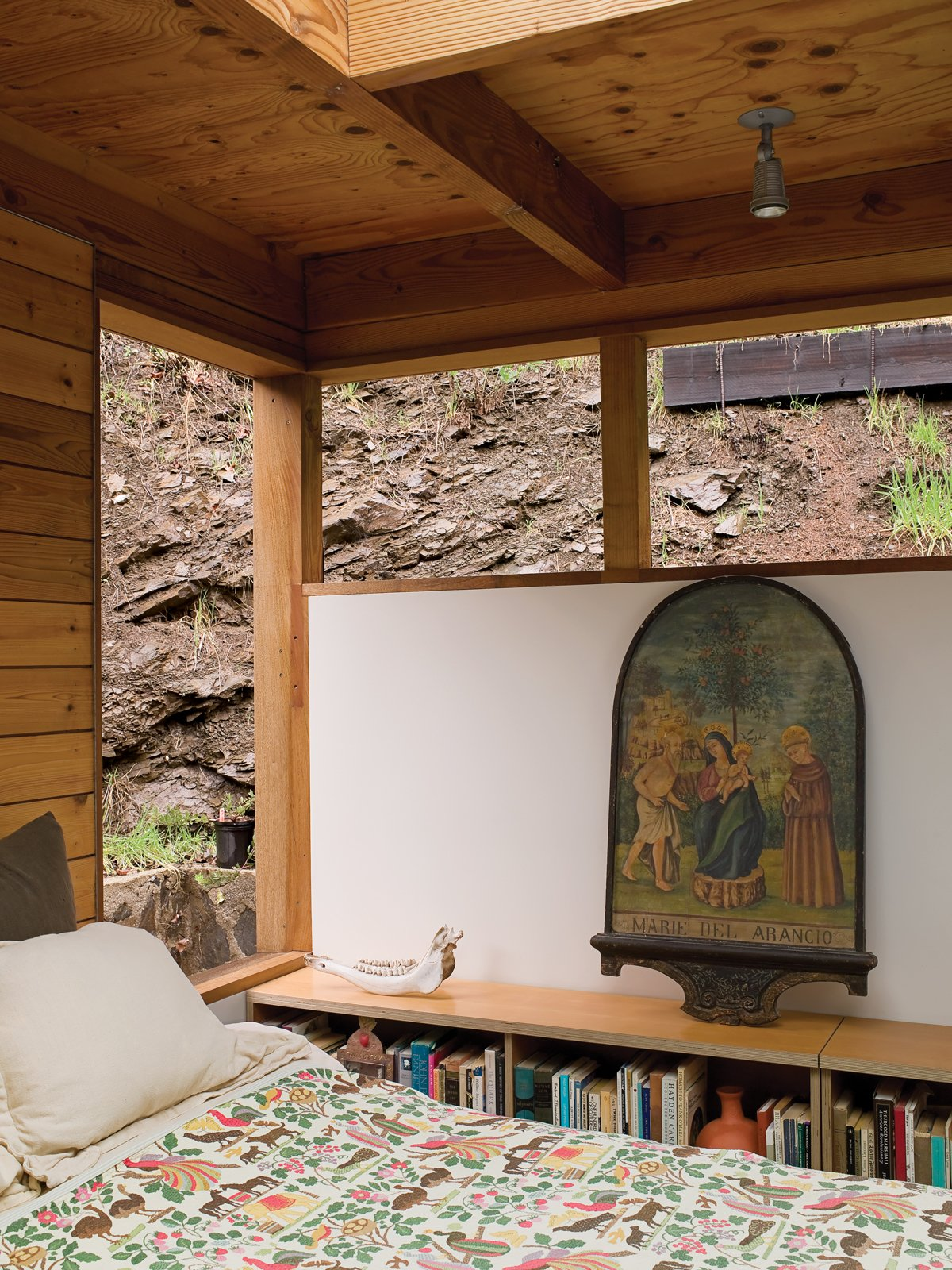 Bedroom and Bed From their bedroom, Hadley and Peter can gaze out at the canyon wall or up through a skylight at the clouds and stars.  Photo 4 of 12 in Compound Addition