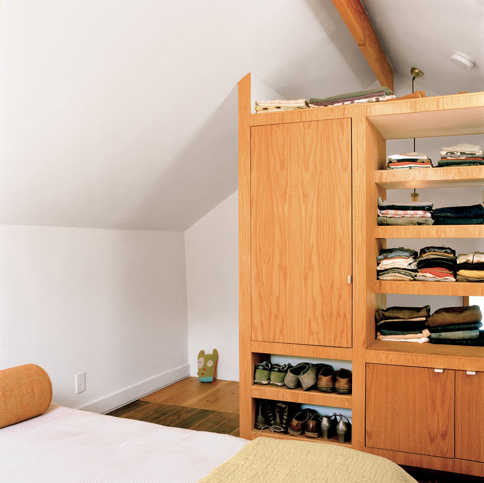 Shelves, Cabinet, Bedroom, and Bed Tolya and Otto's handiwork, such as the cabinetry in the master bedroom, helps keep the lines of the house clean and the rooms tidy.  Best Bedroom Shelves Cabinet Photos from Built-In Style
