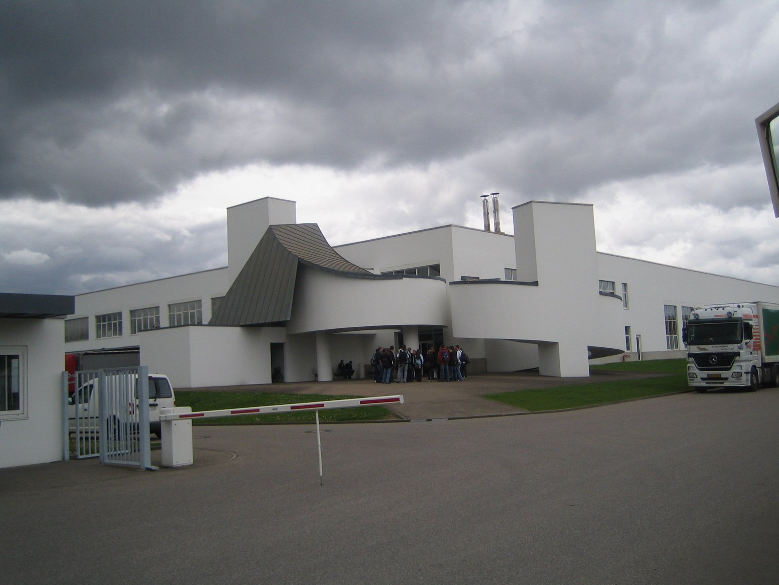 This building by Frank Gehry houses another part of the design collection as well as the cafeteria and a charming Jean Prouvé dining room.  Touring the Vitra Campus  by Aaron Britt