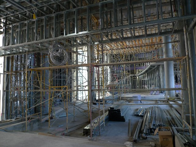 The hotel lobby as entered through the motor court, with a circular staircase at far end.  Photo 2 of 10 in The W Hollywood Residences