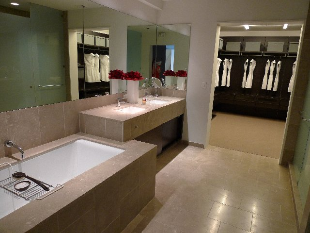 The bathrooms feature fossilized Brazilian limestone, Kohler fixtures, and Poliform closets.  Photo 8 of 10 in The W Hollywood Residences