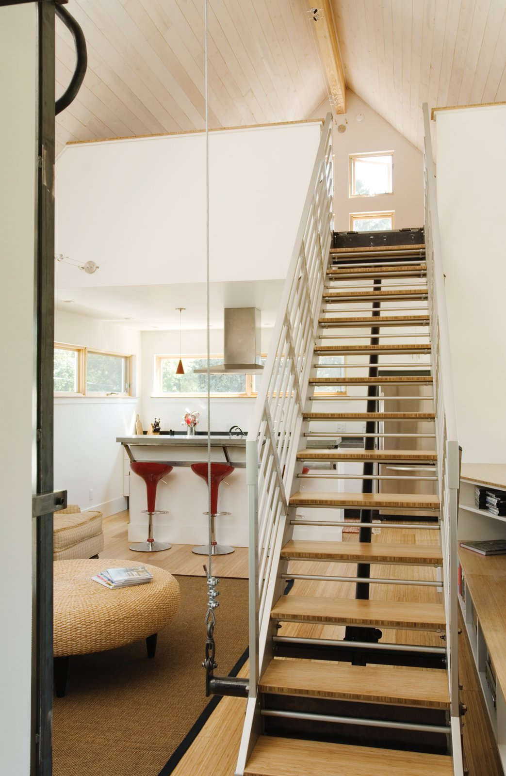 Movement is an inherent part of this small-space solution, and it comes as no surprise that the architects were inspired by automotive industrial designs and the stairs include a vertical track that utilizes modified rubber skateboard wheels.  Interesting from The Best of Small Spaces