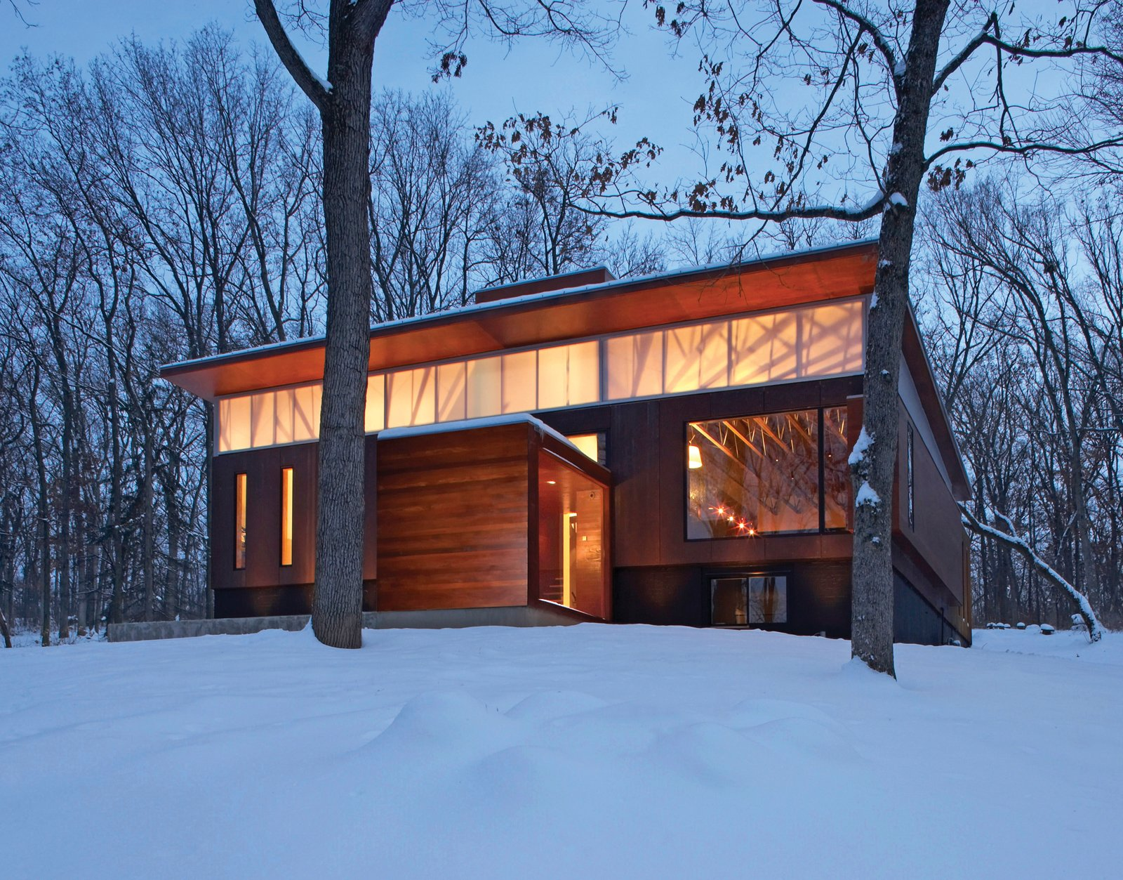 The house is wrapped on three sides with a rain screen of weathering steel panels. On the northern facade, a clerestory window lets in light to illuminate the inside spaces.  Shining Examples of Clerestory Windows by Luke Hopping from The Best of Small Spaces