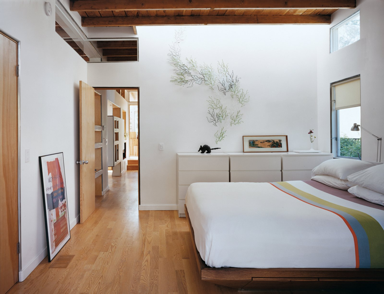 The front bedroom reveals how the design creates through-flow of light and air in what had previously been a poky set of spaces.  Photo 10 of 10 in Casa Study House #1