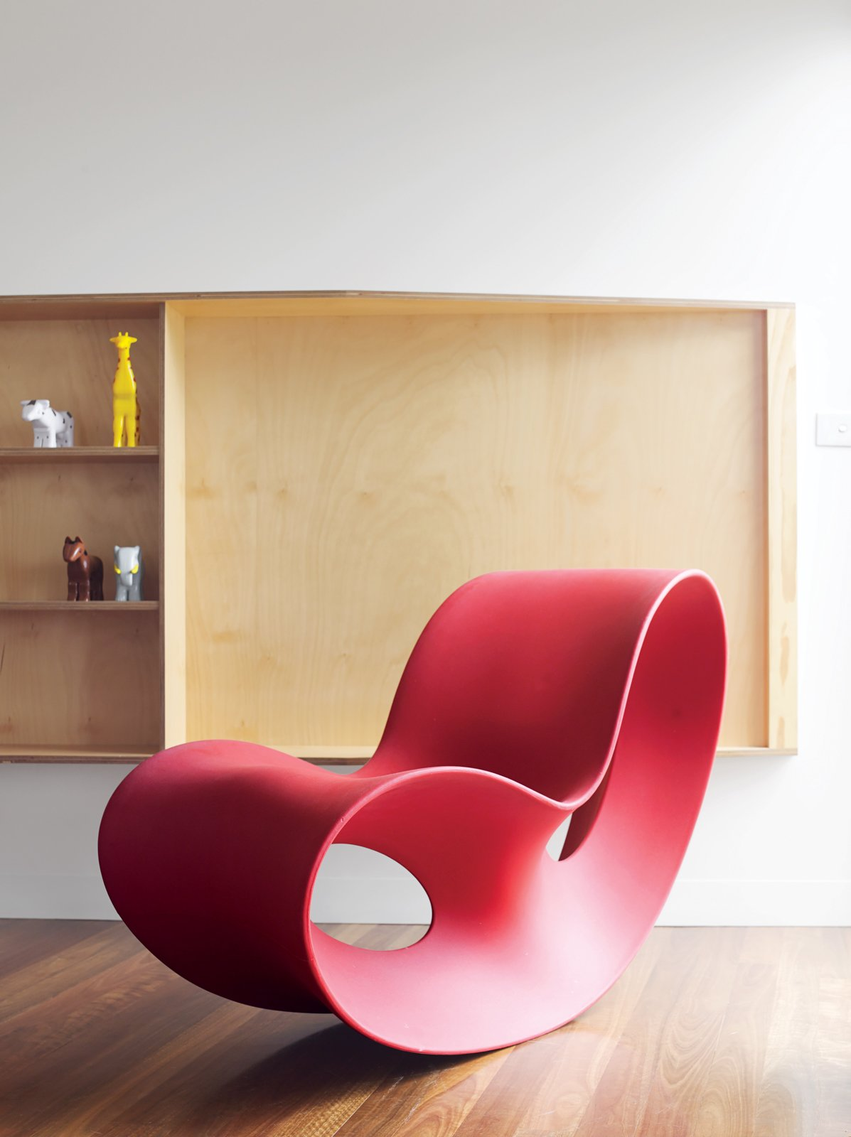 Ferguson's prized Voido rocking chair is positioned by a living-room window that affords views of the small town and its beach. Designed in 2002 by Ron Arad for Magis, the Voido is blow-molded entirely from polyethylene.  Photo 6 of 10 in Pedigree Charted