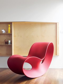 Ferguson's prized Voido rocking chair is positioned by a living-room window that affords views of the small town and its beach. Designed in 2002 by Ron Arad for Magis, the Voido is blow-molded entirely from polyethylene.