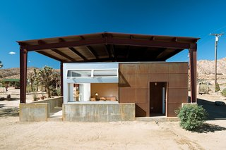 The rustic look of surfwear entrepreneur Jim Austin's home both stands out and also conforms with its rough-and-tumble surroundings in Pioneertown, California.