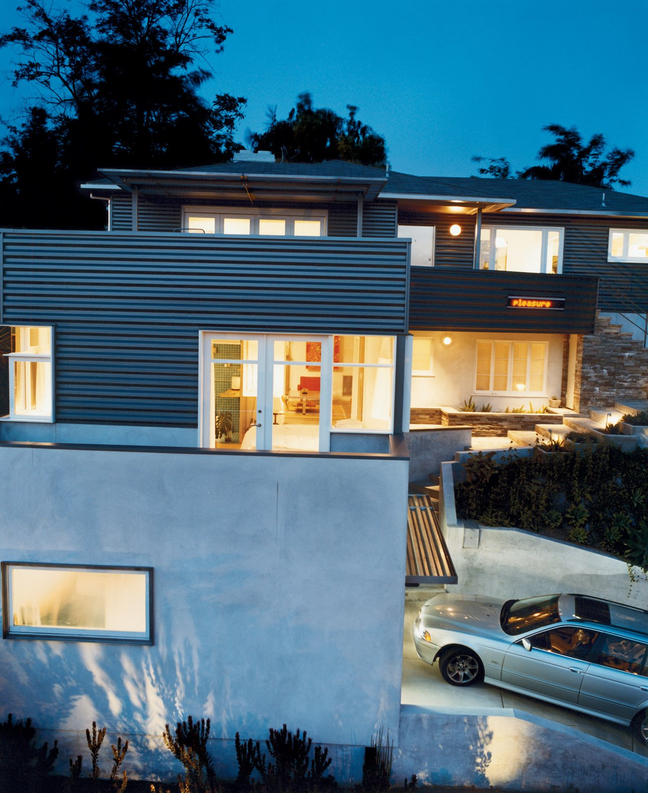 Architect Joe Day and his wife, Nina Hachigian, transformed a 1940s tract house in Silver Lake into a hard-edged but open home that engages the neighborhood and takes advantage of the views.  Photo 1 of 12 in Way Out West