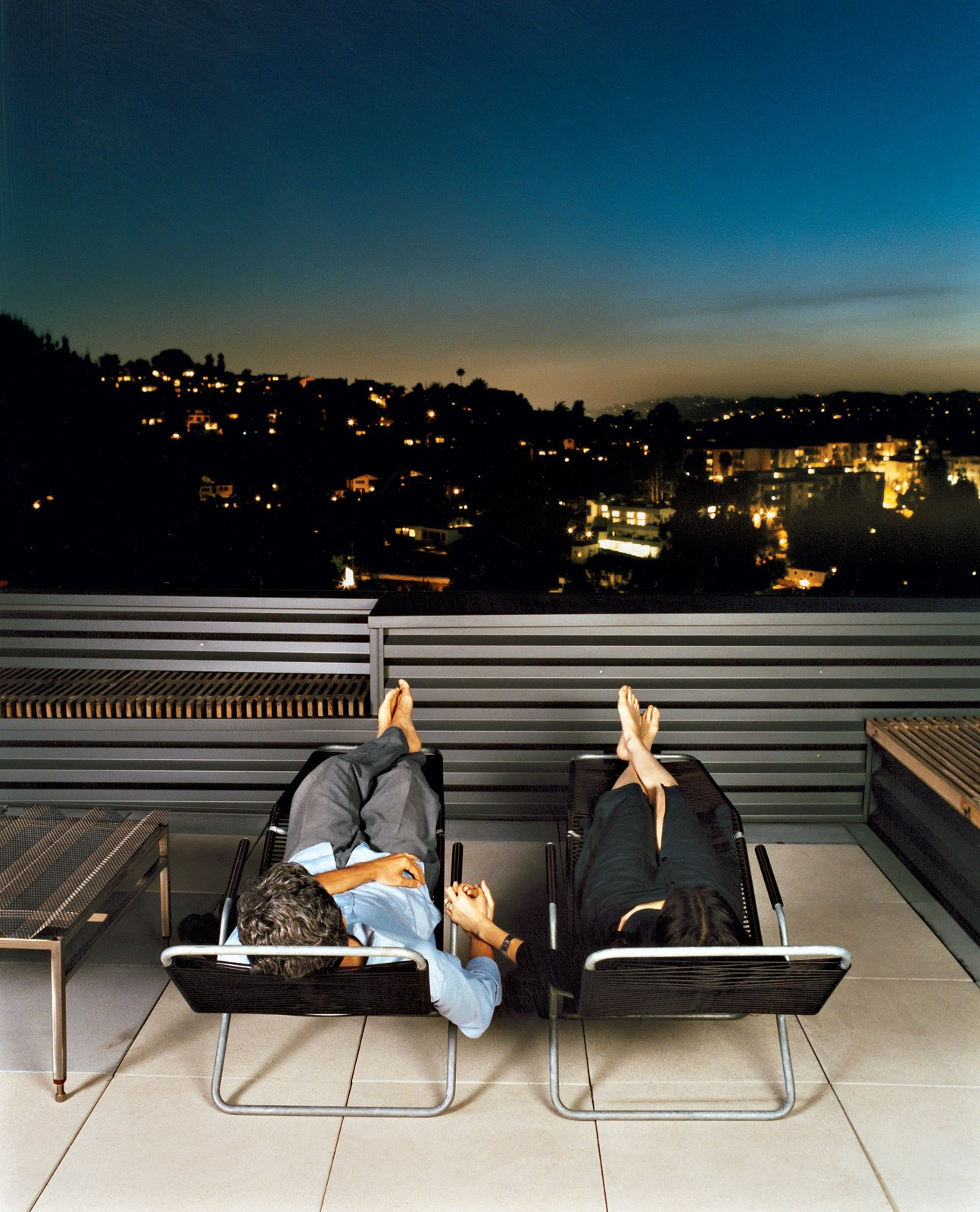Joe Day and Nina Hachigian relax on their terrace overlooking the hills in Silver Lake area of Los Angeles.  Private Rooftop Sanctuaries  by Zachary Edelson