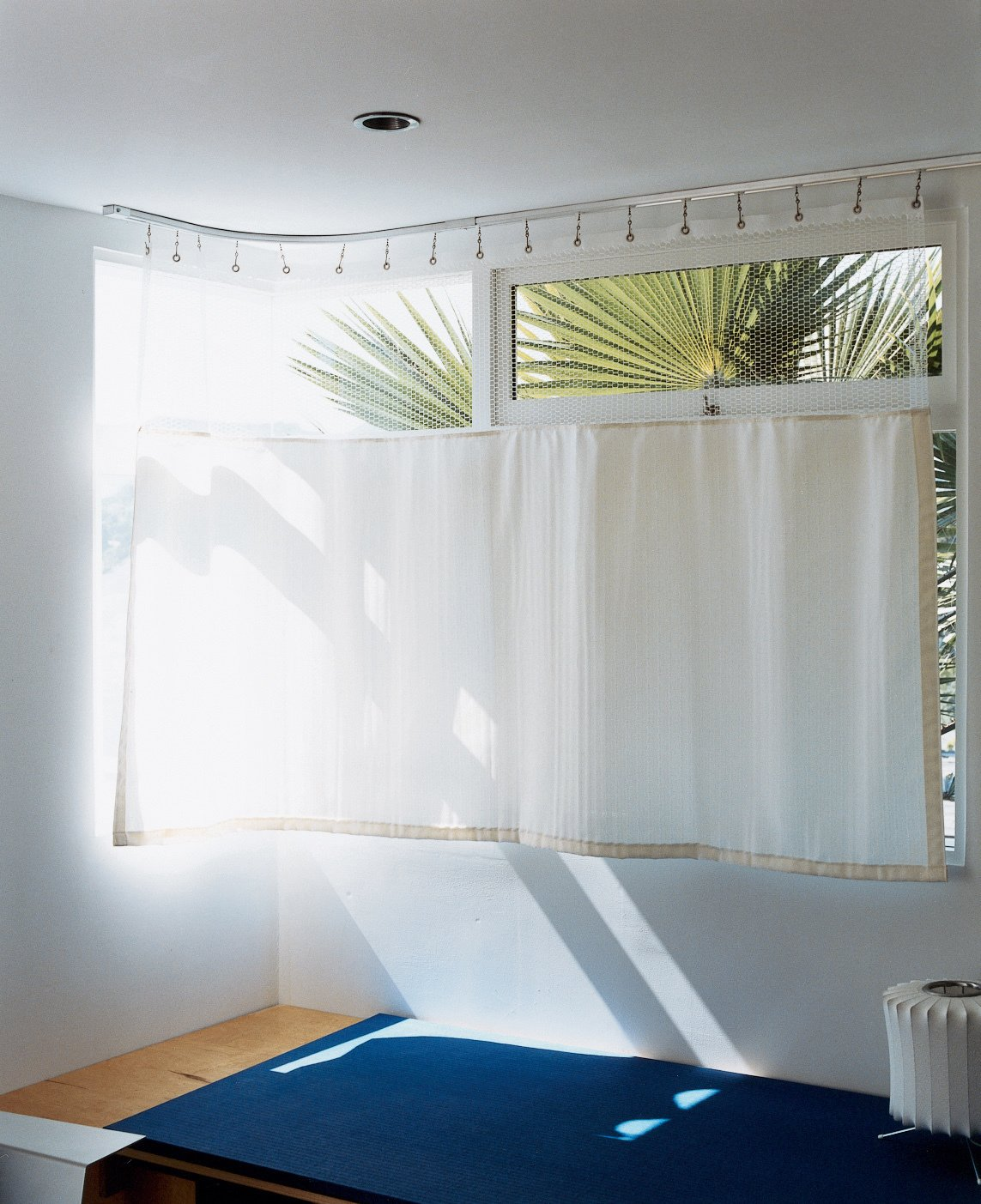 The lower-level guest room, which makes inventive use of a hospital curtain.  Photo 8 of 12 in Way Out West