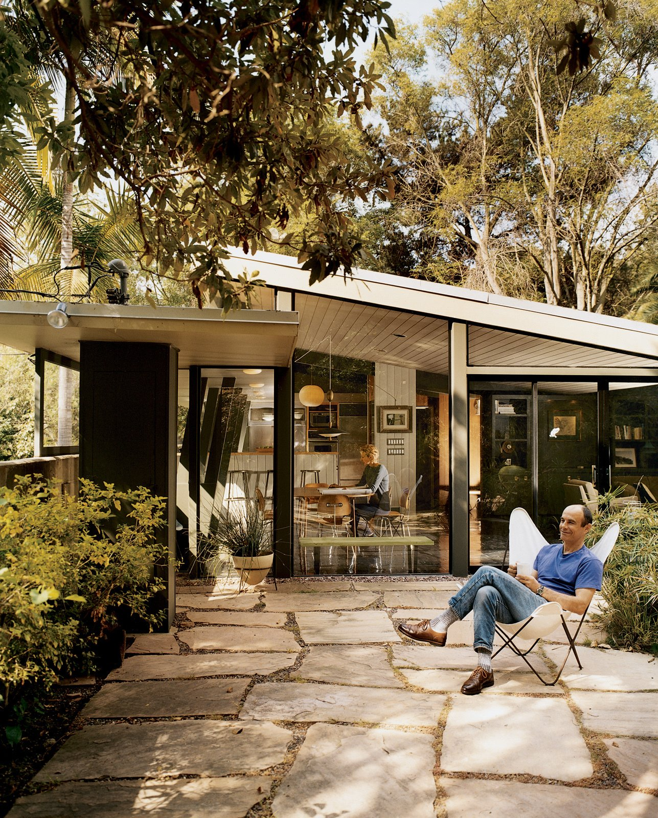 Small Patio, Porch, Deck, Back Yard, Exterior, and House Building Type Buckner and Roberts both expressed admiration for Jones's thoughtful details—including the sloping glass, angled columns, and Wrightian light shelf.  Photos from Mutual Fulfilment
