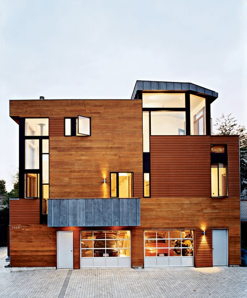 Ample windows cut into the north elevation of the Valentine House, behind which live the architects. The openings reveal lofty double-height spaces inside. The ground-floor garage often serves as a shop for architectural model-making.