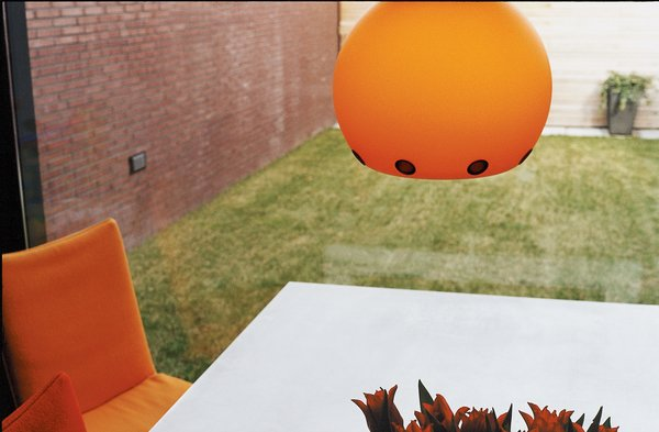 """The pumpkin-orange Dordoni Halloween lamp is both UFO- and sun-like—a slightly humorous and cheering sight on a gray day in Holland. It was chosen, says Dedy, """"simply because it says 'welcome home.'"""""""