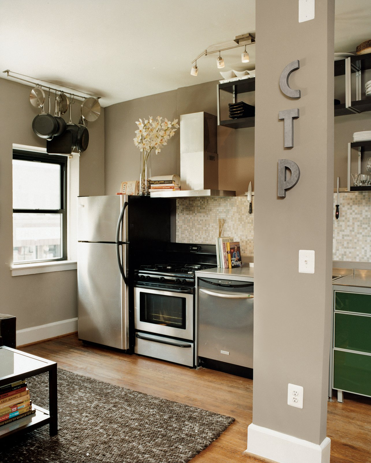Patten's apartment is on the second floor, and though the layouts of the two residences are nearly identical, Patten's initials on a support column clearly mark this space as his own.  Photo 4 of 13 in Hoagies' Heroes