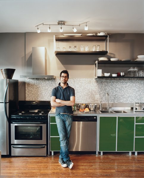 """Mazza and Patten both used off-the-shelf Ikea cabinets in their kitchens. They customized them by raising them up a few inches and dropping a sink into a store-bought table, which serves as the countertop. The pair is thrilled with the results. Even the architects they hired to work at the deli from Grupo 7 were impressed: """"They said, 'These cabinets are insane. How do we get them?'"""" Mazza recalls."""