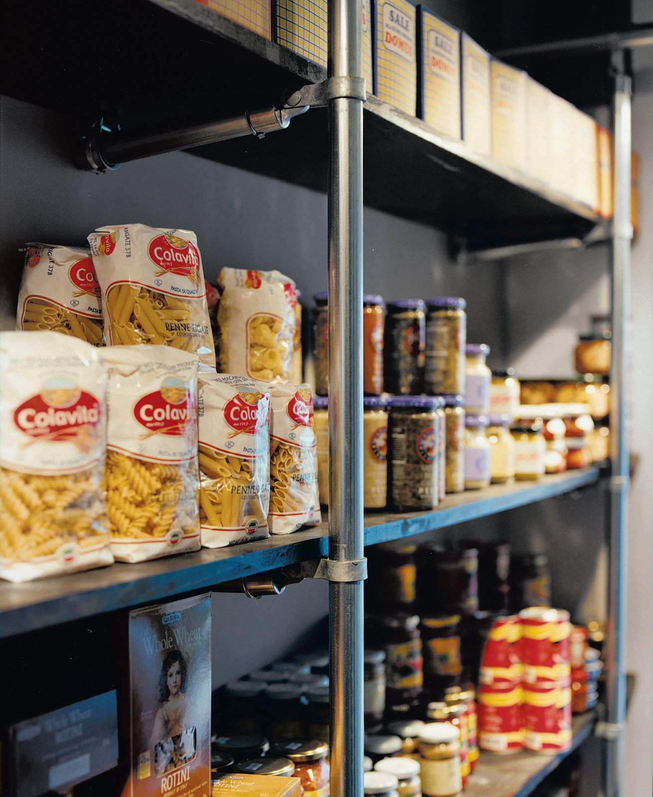 """""""We said to Grupo 7, 'We need you to use the cheapest materials possible, but in a really cool way,'"""" Mazza recounts. Chain-link fence poles hold up the racks of food in the market and support the grid of lights on the ceiling.  Photo 11 of 13 in Hoagies' Heroes"""
