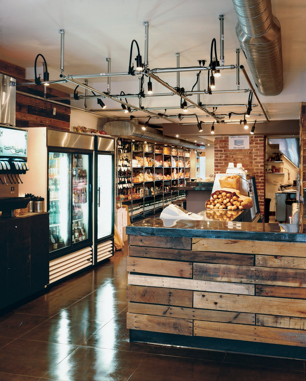 The market's shelves are lined with all manner of Italian goodies, and the lighting grid on the ceiling, made of chain-link fence posts, is a nod to the grids common in Italian delis.  60+ Modern Lighting Solutions by Dwell
