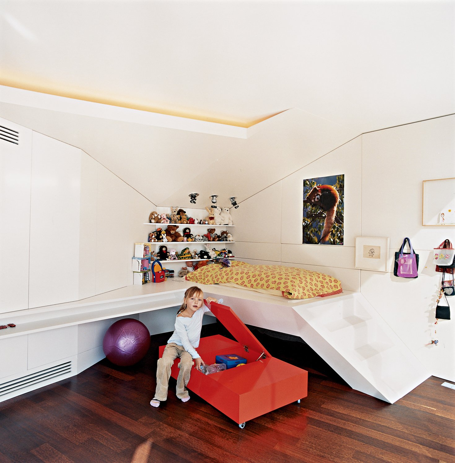 Nora, the architects' six-year-old daughter, hangs out next to her built-in bed.  Photo 6 of 16 in The Penthouse Has Landed