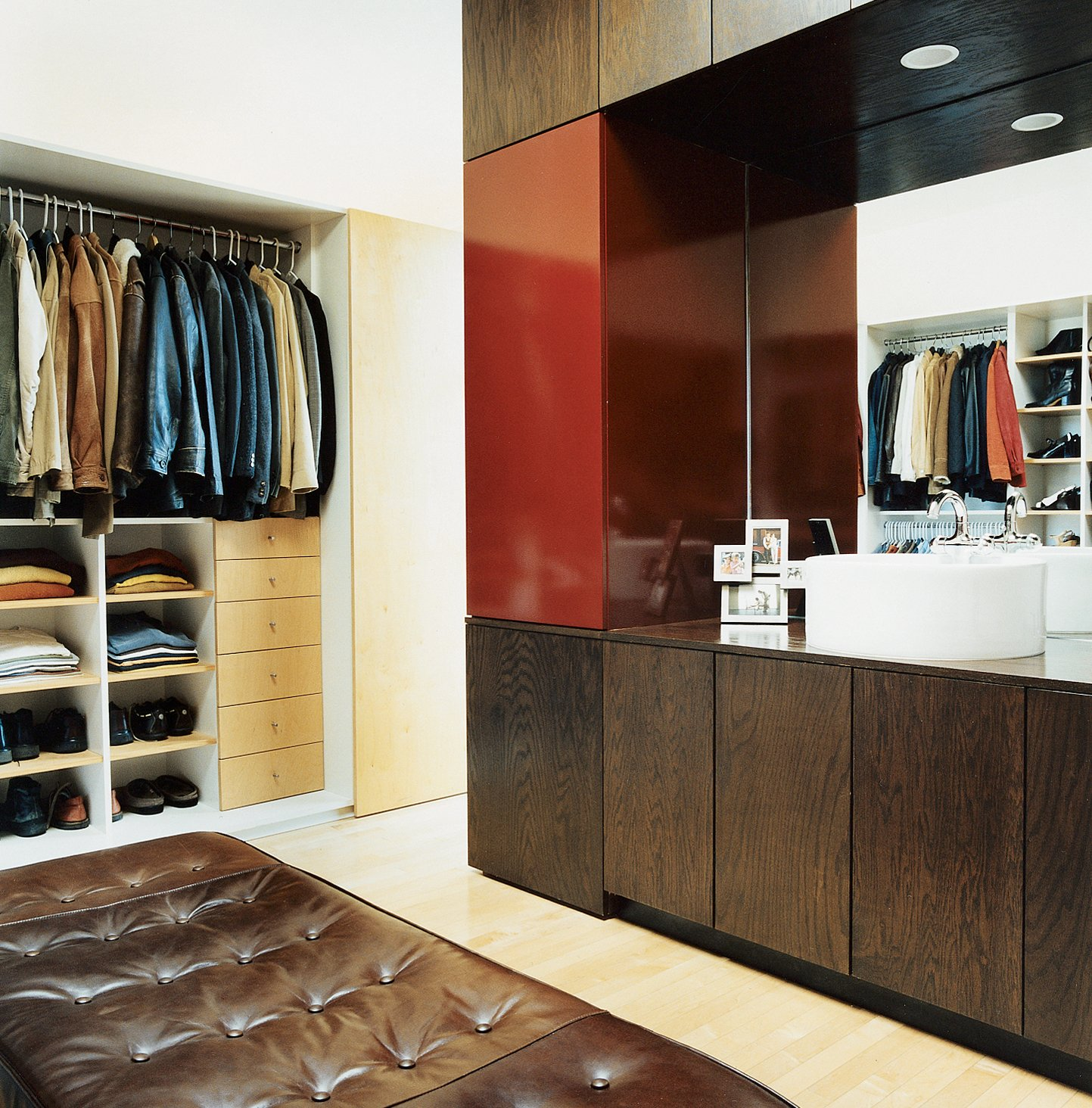 The closet creates order in a space that has potential for disaster.  Photo 3 of 10 in 10 Modern Walk-In Closets from Making Sense of the City