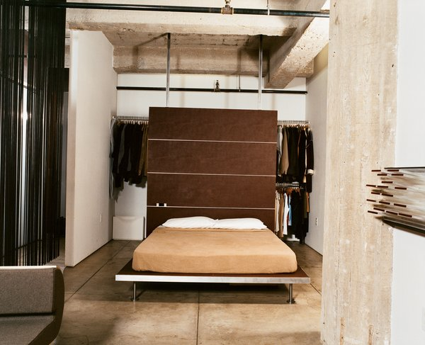 With a push of the sliding door, the bedroom morphs into an extension of the living room, adding much-appreciated square feet during dinner parties and other gatherings. The platform bed and backrest are both Tag Front designs.