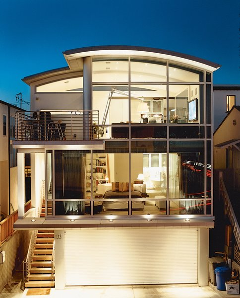 """It didn't bother me to do a house with a lot of things half the size of what people think is normal,"" John Picard says of his half-lot home (above) in Manhattan Beach. The home's steel frame offers a maximum expanse of glass. Because of the small footprint, Picard wanted every inch of the living space to be usable—which is made possible by the steel frame and a service core that runs the entire height of the building."