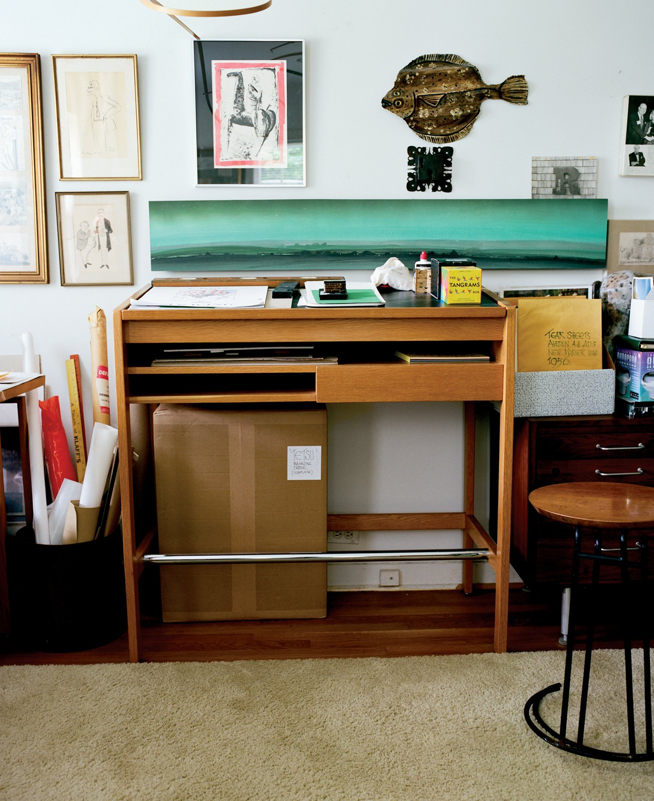 A workstation in Risom's office (bottom) shows evidence that the designer is still very much active; a pile of sketches sits in the basket to the left of the table, and ephemera from early Jens Risom Design marketing material decorate the wall.  Photo 3 of 6 in Fascinating Risom