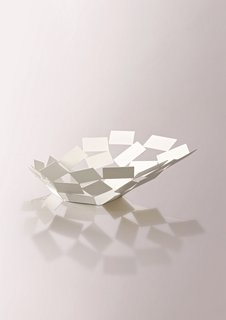 La Stanza dello Scriocco bowl, by Mario Trimarchi for Alessi.  Capturing the fluid movement of cards caught in a gust of wind, this is a really lovely collection.