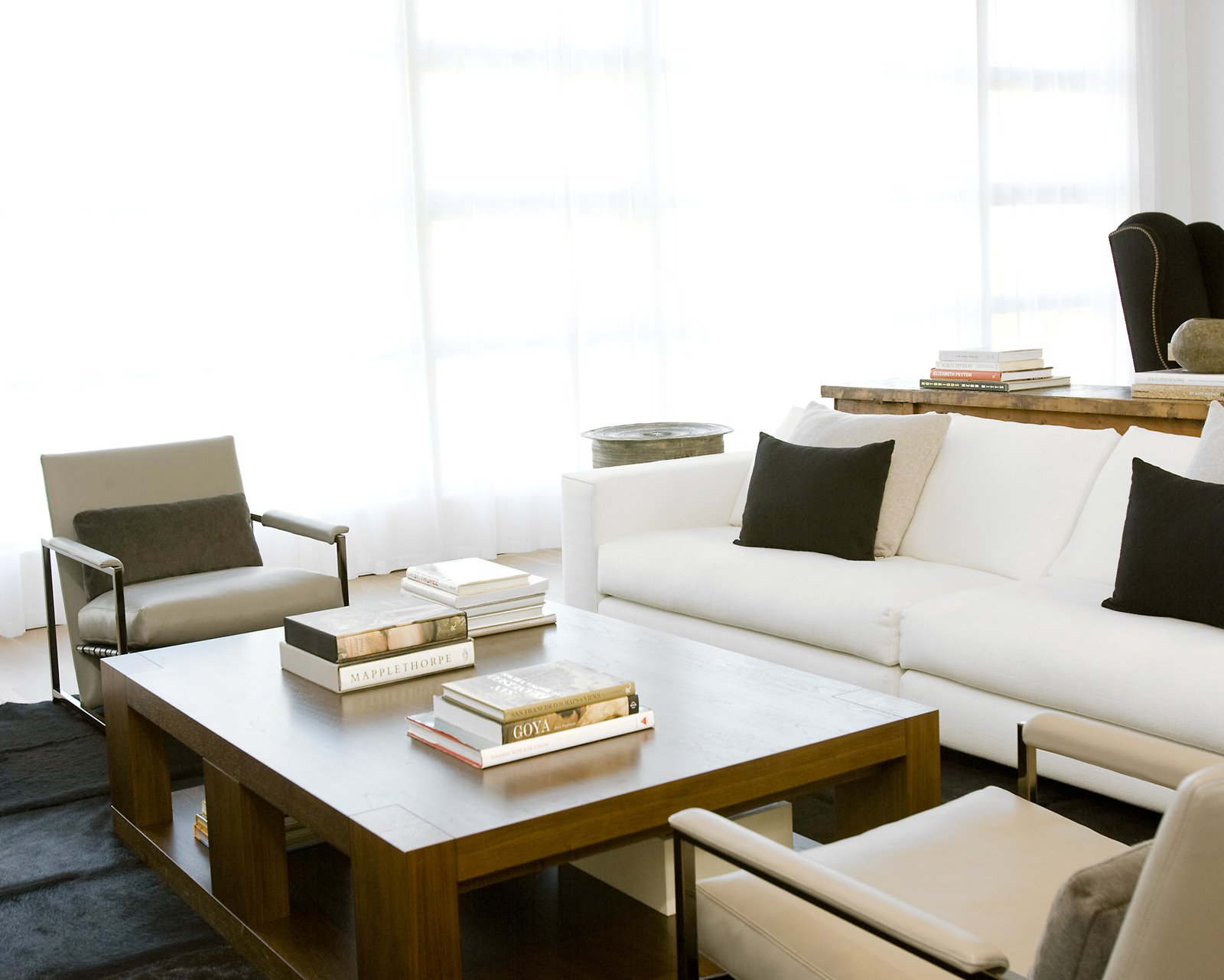 Hollis outfitted the living room with a sofa and lounge chairs from Minotti, a coffee table from Holly Hunt, and custom built-in bookcases (see previous photo) by CHM.Photo by   Ben Mayorga Photography  Photo 5 of 10 in Pacific Heights Remodel