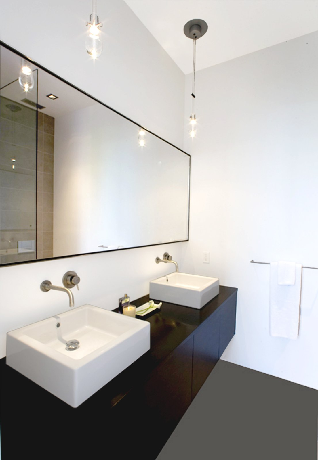 In the master bathroom, Hollis designed a custom floating oak vanity with two sinks, outfitted with Boffi fixtures.Photo by   Ben Mayorga Photography  Photo 9 of 10 in Pacific Heights Remodel