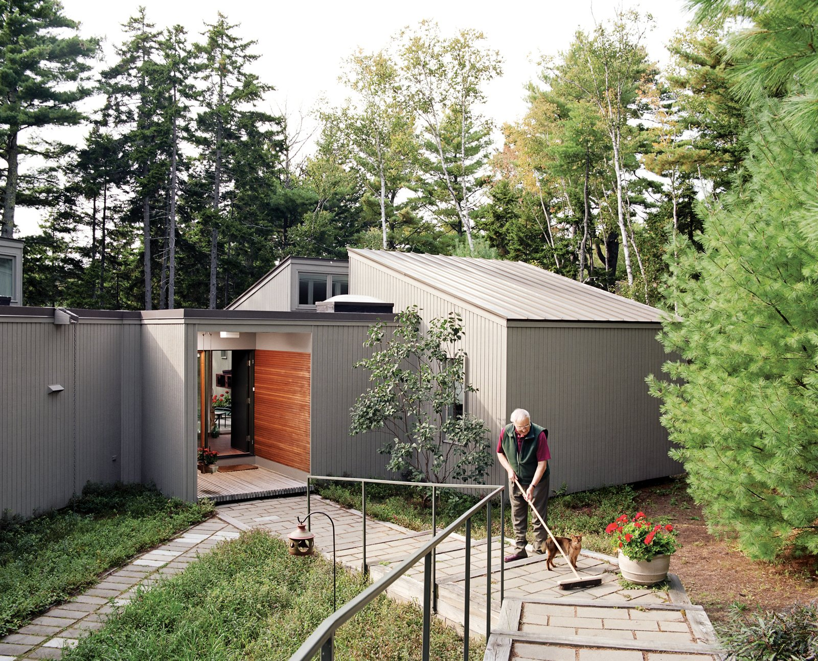 Outdoor and Front Yard A series of long stairs leads to Maison Amtrak, which is set below street level. The entranceway demonstrates Cohen's love of Japanese design with a geometric simplicity matched only by the formal elegance of the stained Douglas fir two-by-fours.  Best Photos from The Right Track