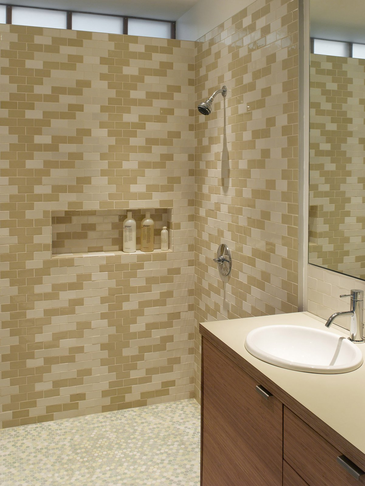 """The Ellers wanted their main bathroom to be lined with tiles but the expense was a limiting factor. To overcome this, Katie made frequent trips across the Golden Gate Bridge to Heath Ceramics in Sausalito to purchase seconds. """"She collected boxes and boxes over time, and then we arranged what she had in this pattern,"""" Willmer says.  Photo by   Ken Gutmaker  Photo 12 of 14 in Park Street Renovation"""
