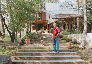 """Architect and builder Ken Meffan lives in Rough and Ready, California, a tiny town in the foothills of the Sierra Nevada mountains. """"Rough and ready"""" also describes his take on domestic bliss: Meffan, 56, is known for his rugged, modern houses in the High Sierra. But when it came to creating his own homestead, he, his wife, Sue, and their four kids roughed it for over a decade (two years in a tent and nine in a workshop) while he built his family's home by hand."""