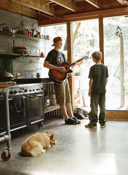 Cody, 17, and Dylan jam in the kitchen with Yogi, the Welsh corgi.