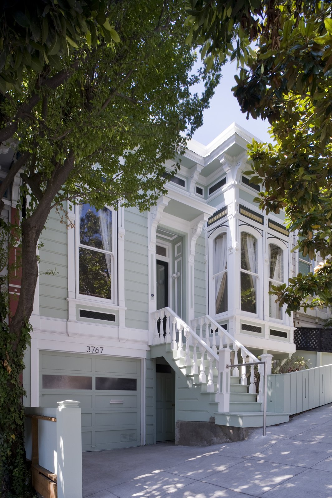 """In 2006, when couple Barnaby Grist and Ellen Goldberg hired Bassel Samaha and Heather Hart, of Samaha + Hart Architecture, they came to the husband-wife design team with big plans. The couple wanted to keep the existing facade as well as the two rooms that flanked the front door true to their early-1900s design, but completely renovate the rest in a modern style. """"They were pretty adventurous,"""" Samaha recalls. """"They wanted what was new to be really different.""""  Photo courtesy of Samaha + Hart Architecture  Photo 1 of 17 in Noe Valley Renovation"""