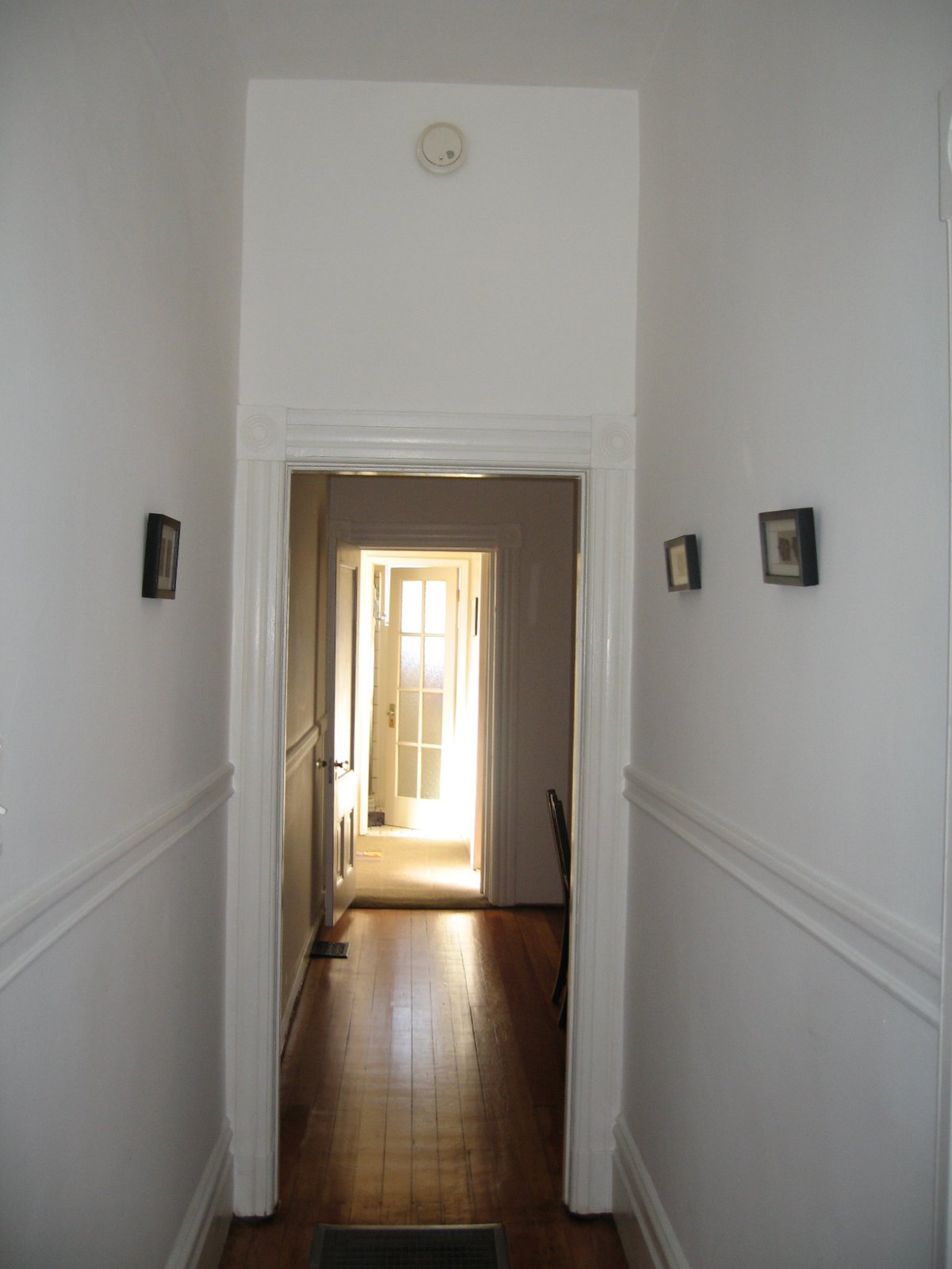 Before the renovation, the house was composed of dark, discreet rooms that lacked connection to one another or the exterior. The view here is from the front door toward the back of the house.  Photo courtesy of Samaha + Hart Architecture  Photo 8 of 17 in Noe Valley Renovation