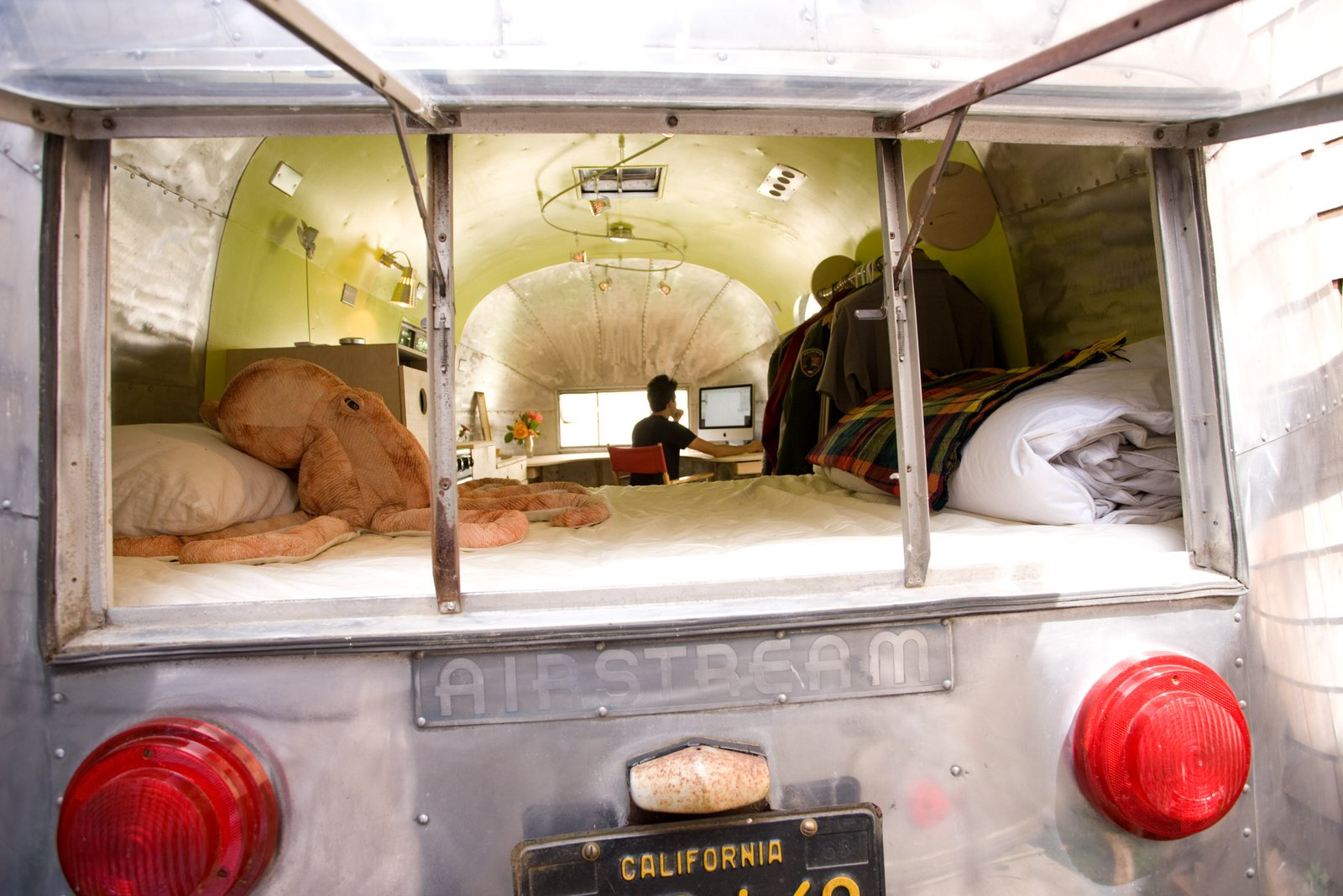 I did restoration work on the exterior as well.  Polishing the aluminum skin was an exercise in patience!  I restored the lights, and retouched the original license plate. I wanted the space to be alluring from all angles, inside and out.  Photo 7 of 8 in The Airstream Life