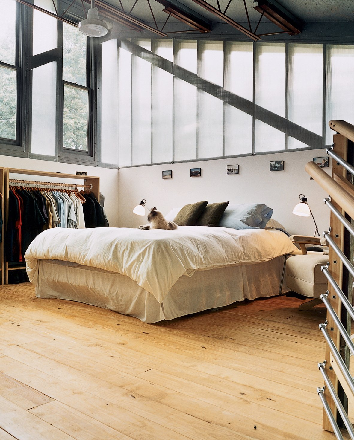 No alarm clock needed here. The highest point in the house is the bedroom, bathed in light from two walls made predominantly of windows and a third completely open to the rest of the house.  Photo 7 of 8 in Mid-City Modern