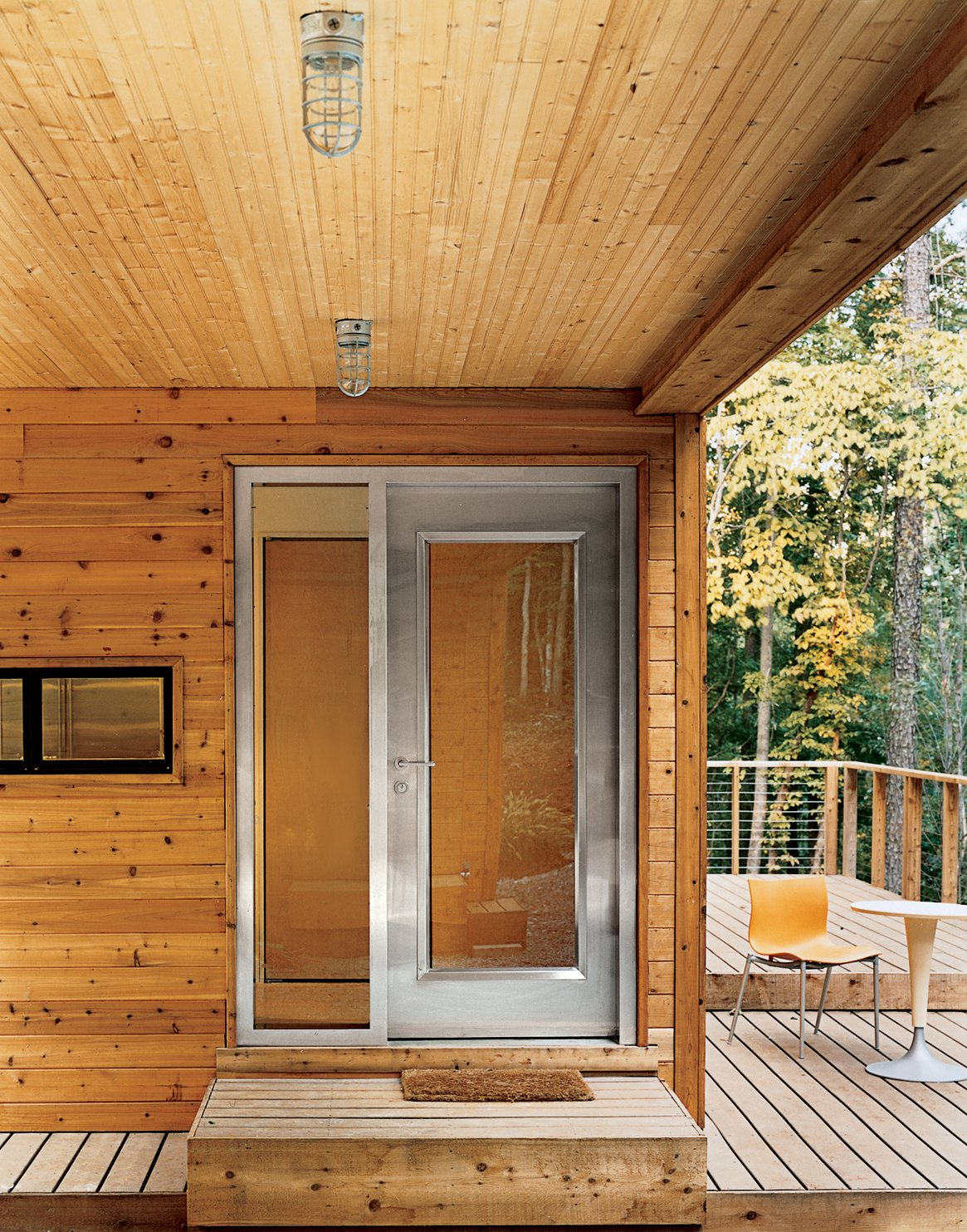 The house is entered through a Visteon steel door by Neoporte, who also provided the solid core birch interior doors.  Photo 4 of 12 in Prefab, Proven