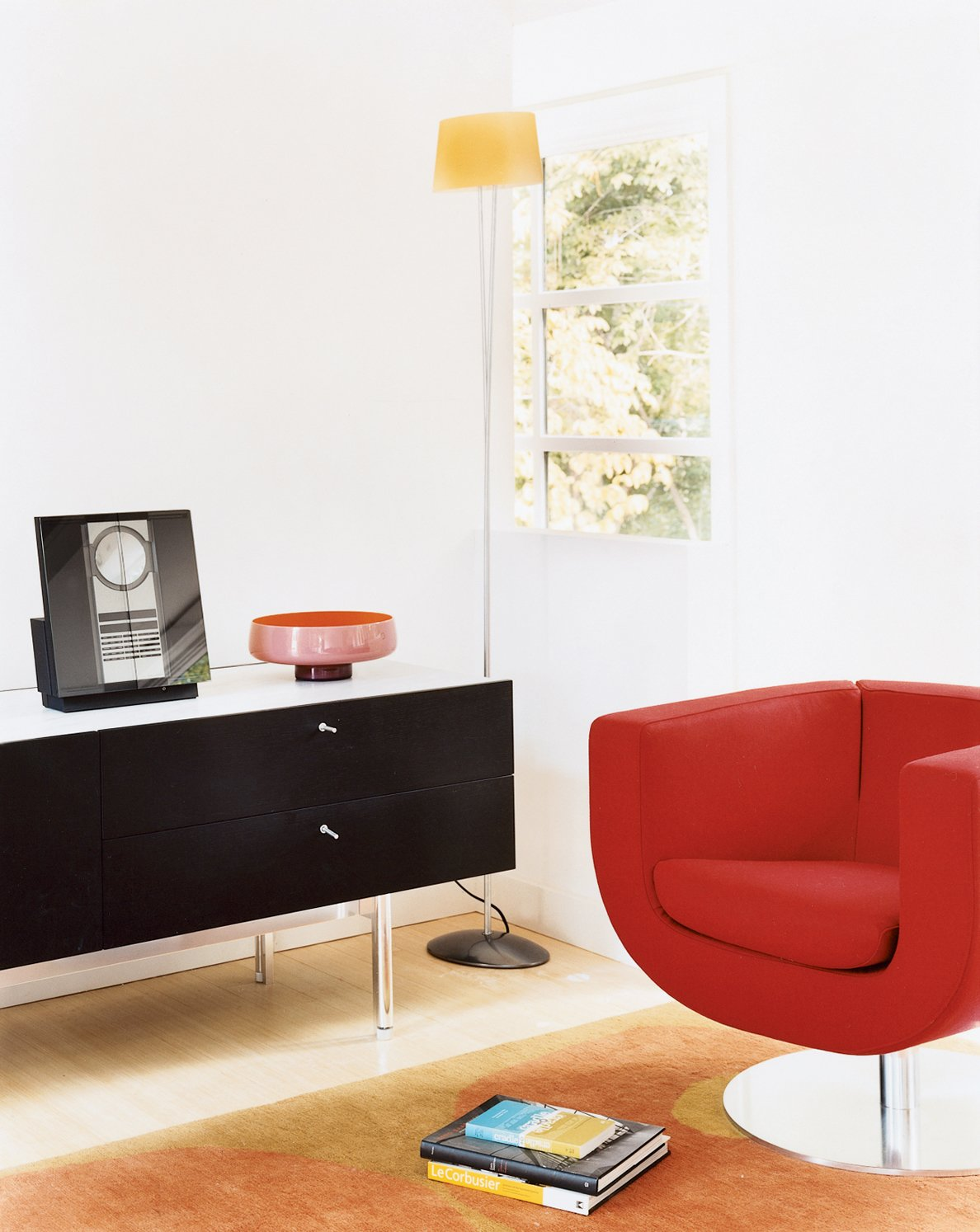 When Wieler and Tung are in their office (if they can resist the lure of the roof deck), they can work or just relax in this happy Tulip chair designed by Jeffrey Bernett. Sound system by Bang & Olufsen.  Photo 8 of 12 in Prefab, Proven