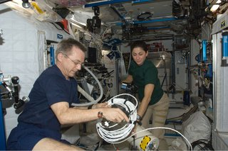 Canadian Space Agency astronaut Robert Thirsk and NASA astronaut Nicole Stott, both Expedition 21 flight engineers, work in the Harmony node of the International Space Station. Photo taken October 11, 2009.   Courtesy of NASA