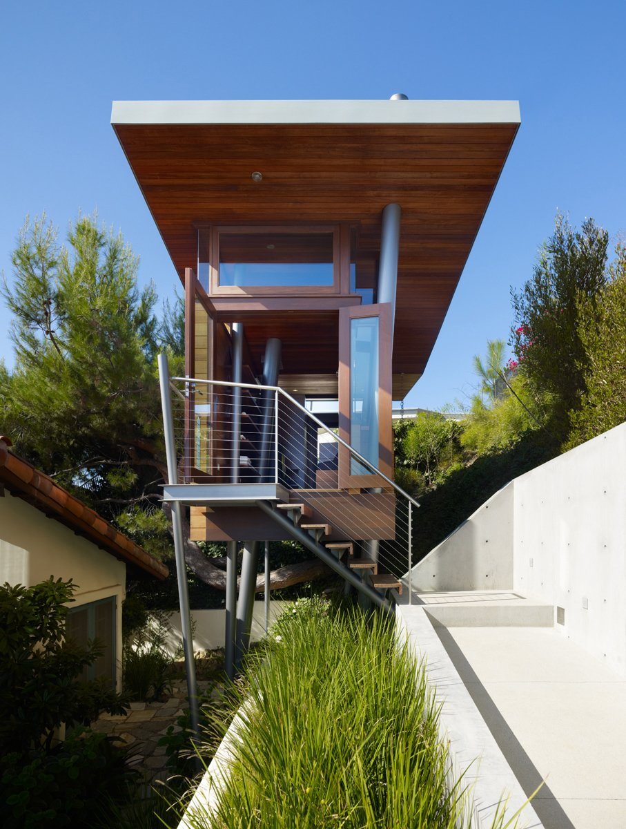 A clerestory around the perimeter of the butterfly roof gives an illusion that the roof floats over the box of the treehouse.  Photo 15 of 25 in Photo Essay: Enchanting Tree Houses from An Atypical Tree House