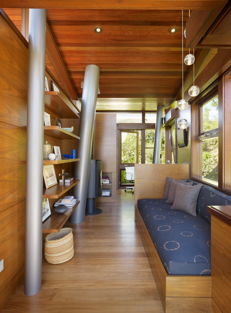 Living Room and Bench The architects took about eight months to design the treehouse. Construction of the inhabitable sculpture, with its studio and lounge, took another 18 months.  Photo 9 of 11 in An Atypical Tree House
