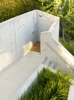 The outdoor shower below the treehouse was shaped and formed from concrete to be a truly private experience.