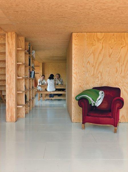 Cubic bookshelves do double duty as a dividing wall and as a sliding door.
