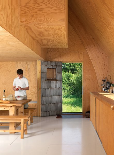 Built in 18 months on a budget of $105,000, this charming A-frame saves on costs with an interior lined with exposed plywood.