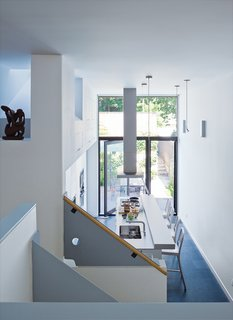 Since the room is at the windowless middle of the house, it borrows light from the kitchen, which, despite its pristine Bulthaup cabinetry and hardware, is the laid-back heart of the house. Chong took advantage of the one-and-a-half-height ceiling to establish some well-hidden  storage cabinets.